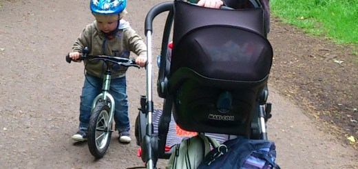 baby in the buggy and toddler on a balance bike
