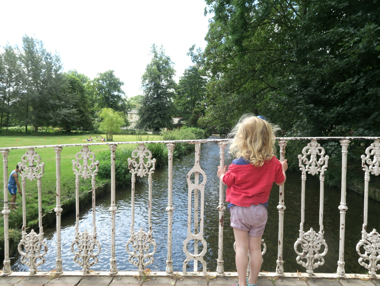 My daughter on the bridge at Morden Hall park, where she saw her first theatre performance at an open air production in the National Trust property rose garden