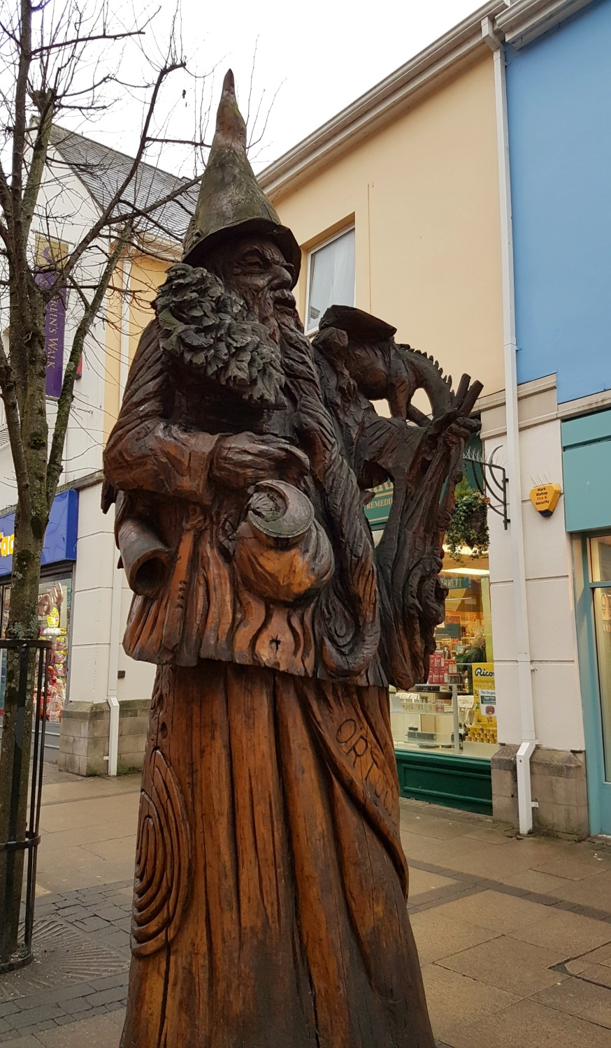 The statue of Merlin where Merlin's Oak once stood in Carmarthen, Wales -on our journey to discover Welsh legends