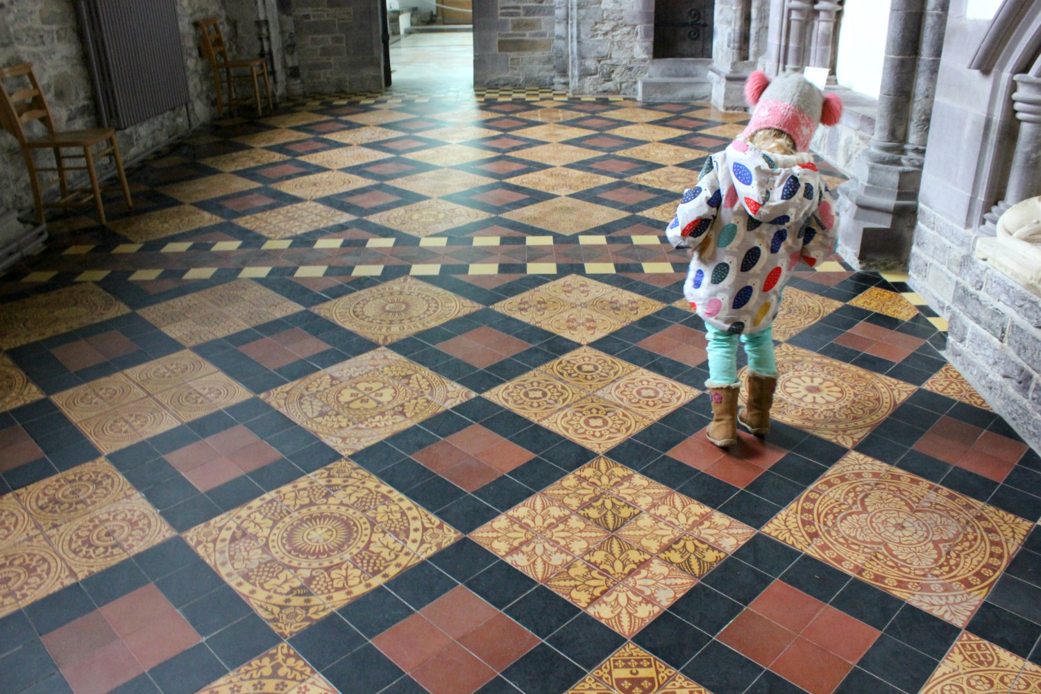 Girl on the ornate tiled floor of St David's Cathedral - on our journey to discover Welsh legends