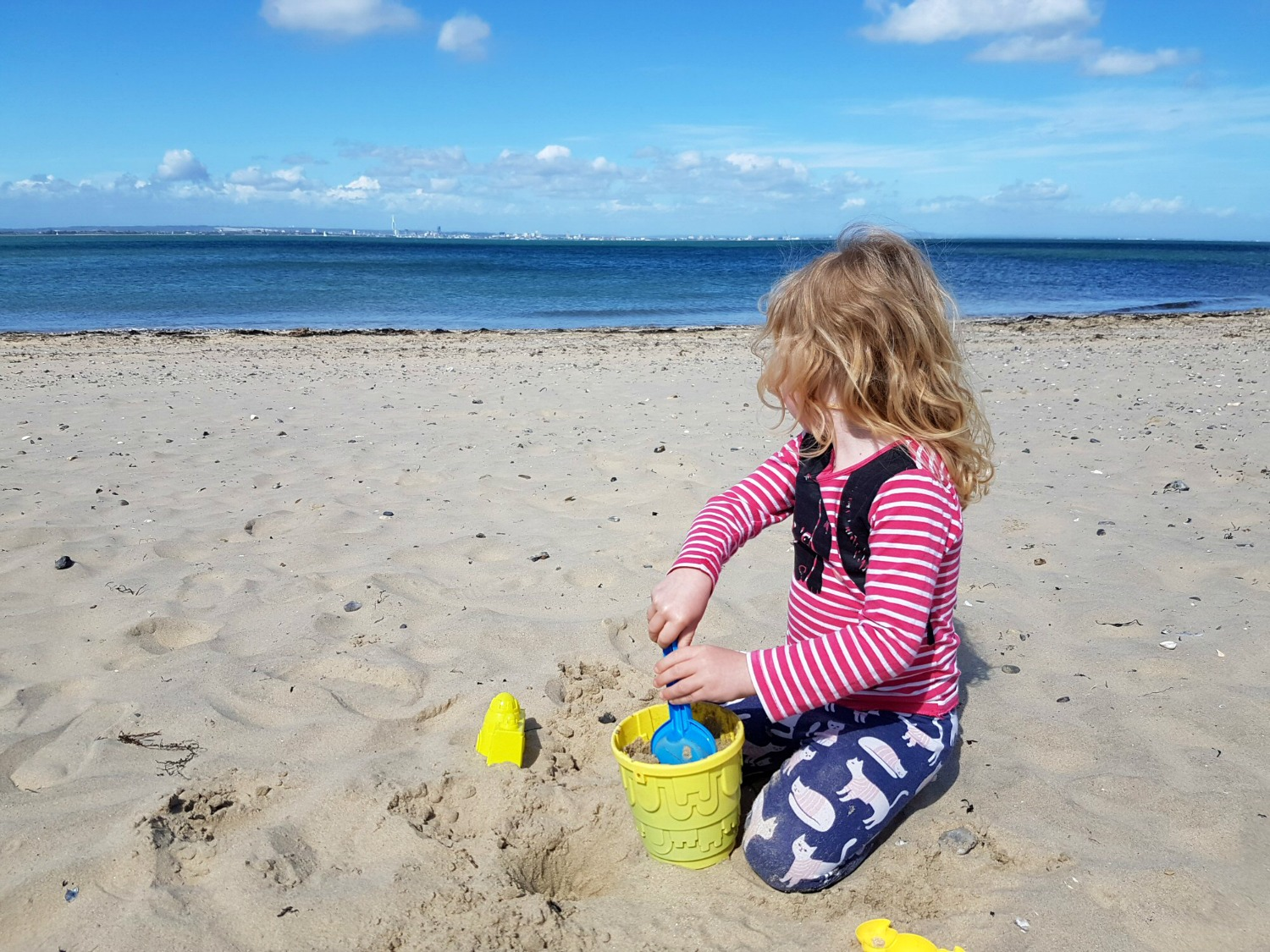My daughter with bucket and spade on the beach at Appley near Ryde, looking back towards Portsmouth - discovering the Isle of Wight coast