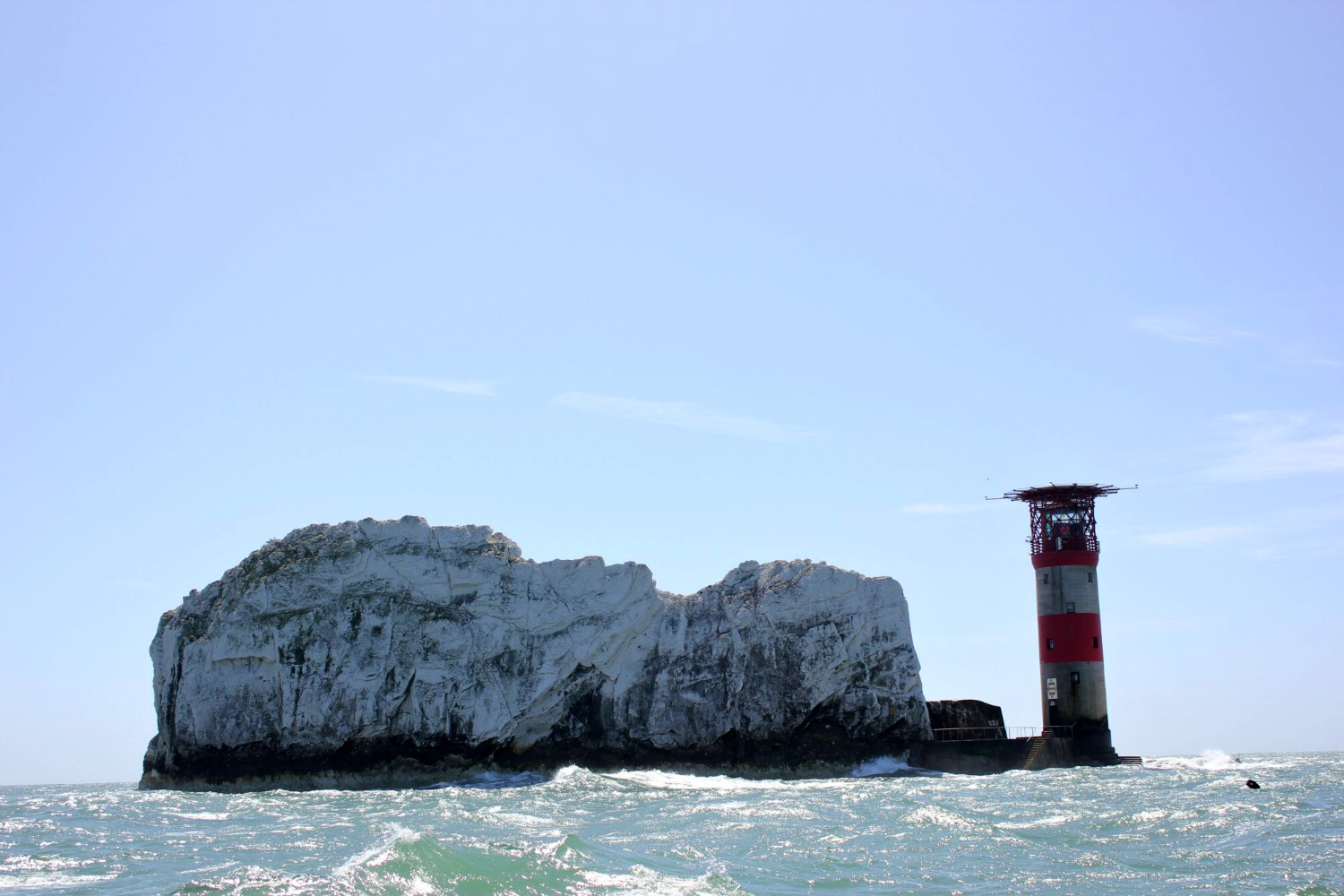 A view to The Needles and lighthouse from our boat - discovering the Isle of Wight coast