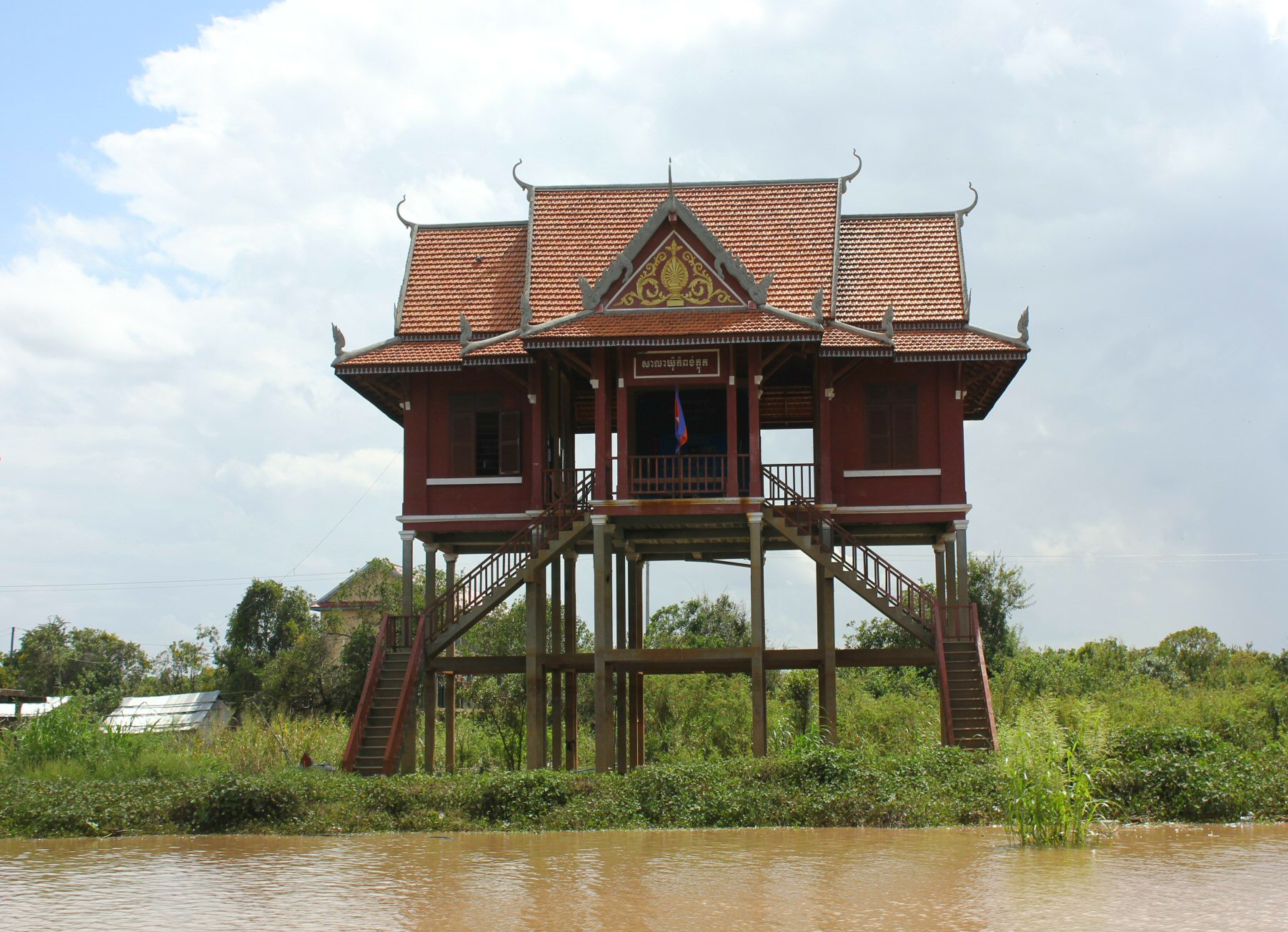 A stilt house by the river near Tonle Sap lake - 12 reasons to visit Cambodia with kids