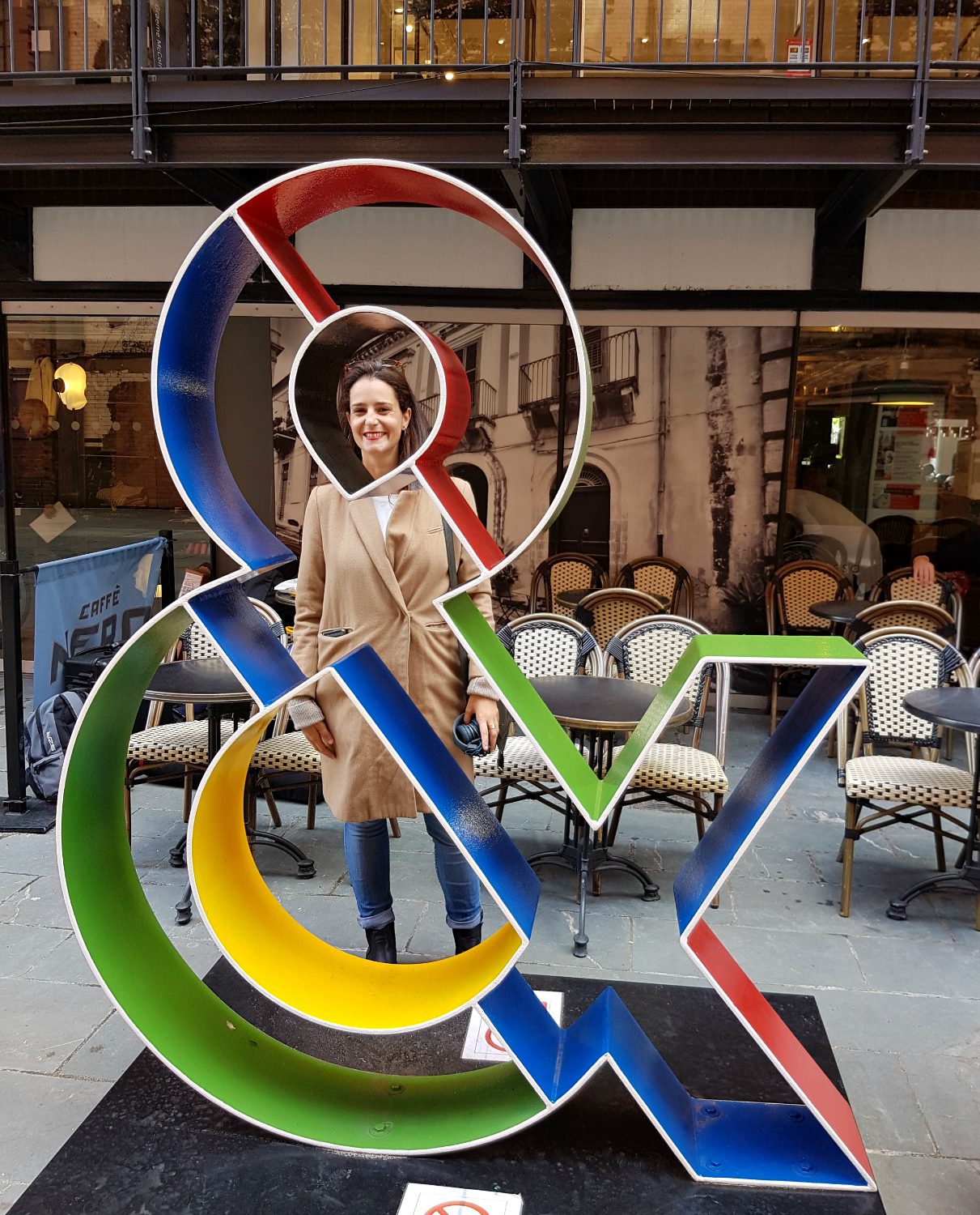 Maria from One Tiny Leap blog stands by a colourful ampersand sculpture - my London Instawalk along the South Bank