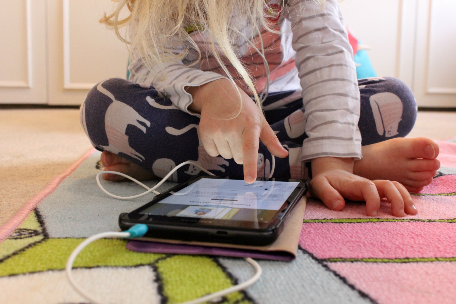 My daughter finding a story on the BookBeat app on a tablet