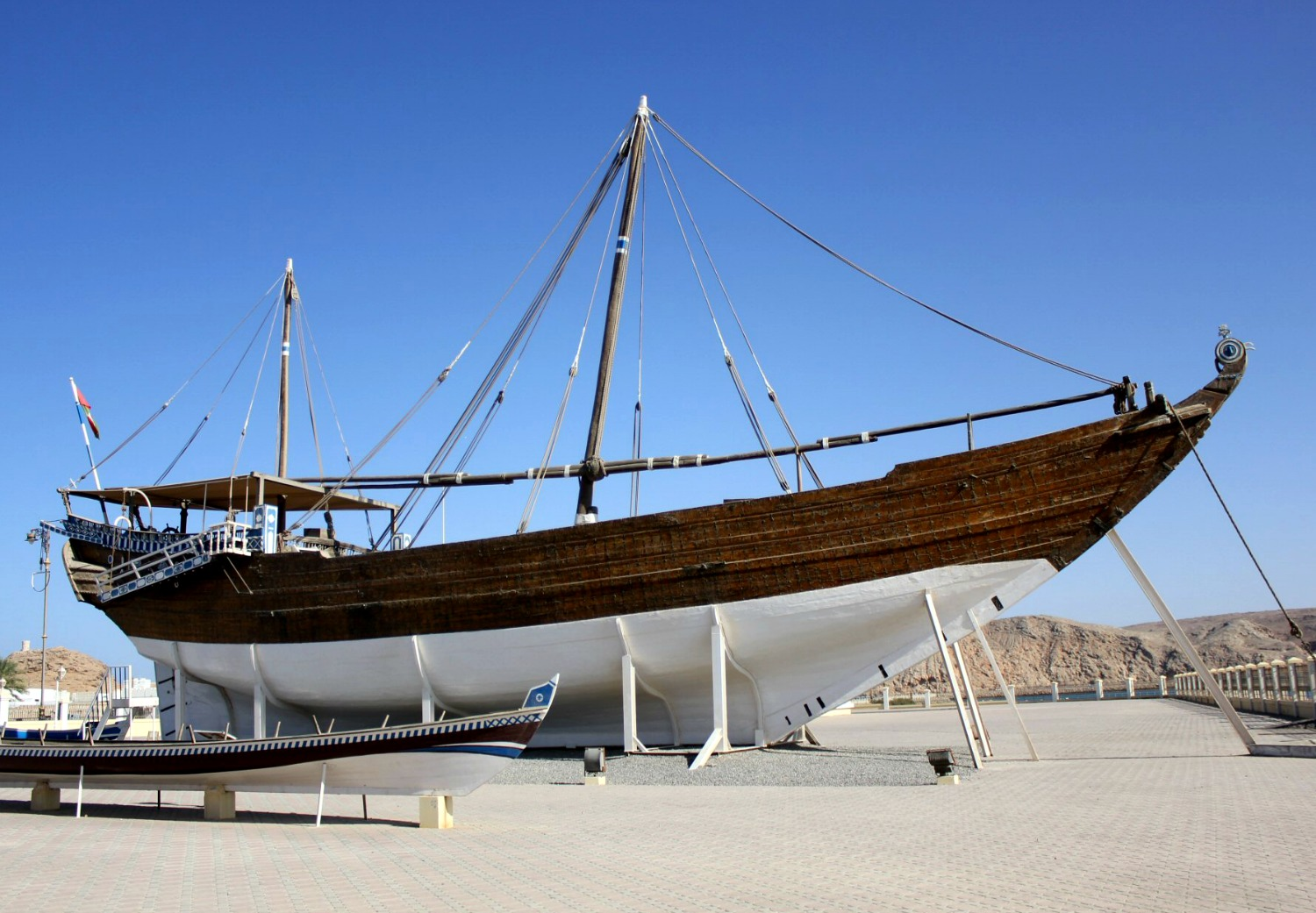 A historic dhow boat with white hull against a blue sky at Sur in Oman - my nine reasons to visit Oman with kids