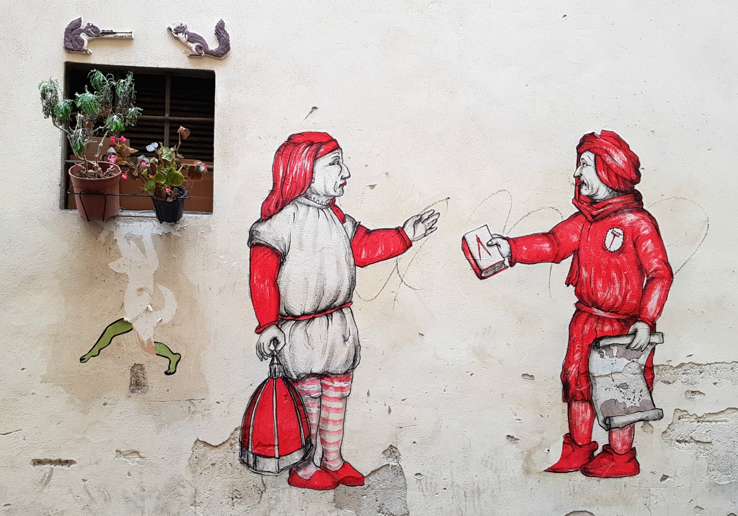 Street art showing figures in traditional dress in Florence, Italy - my Uffizi tour with kids and gelato making day in Florence