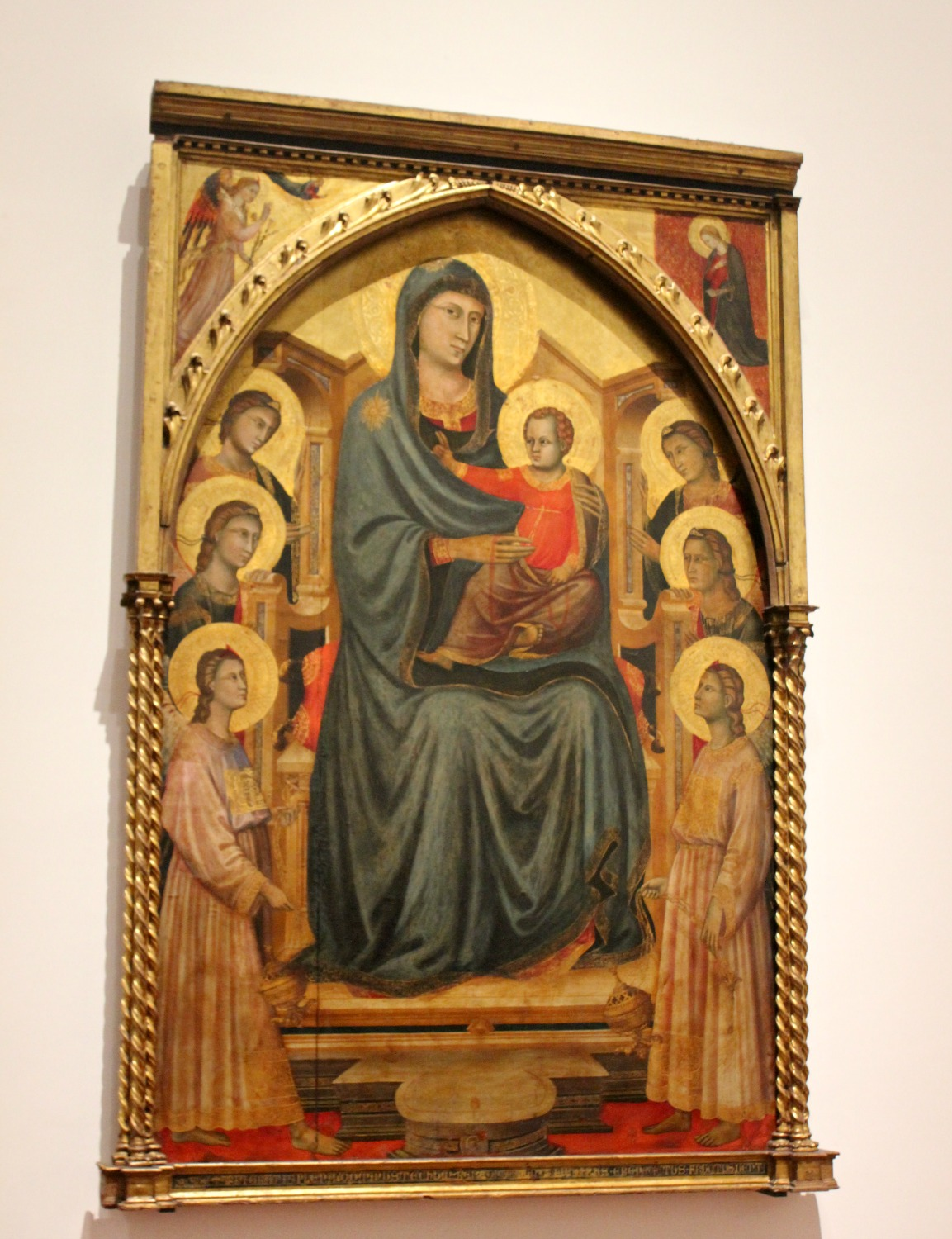 Gilded religious artwork of a Madonna and child at the Uffizi gallery in Florence, Italy
