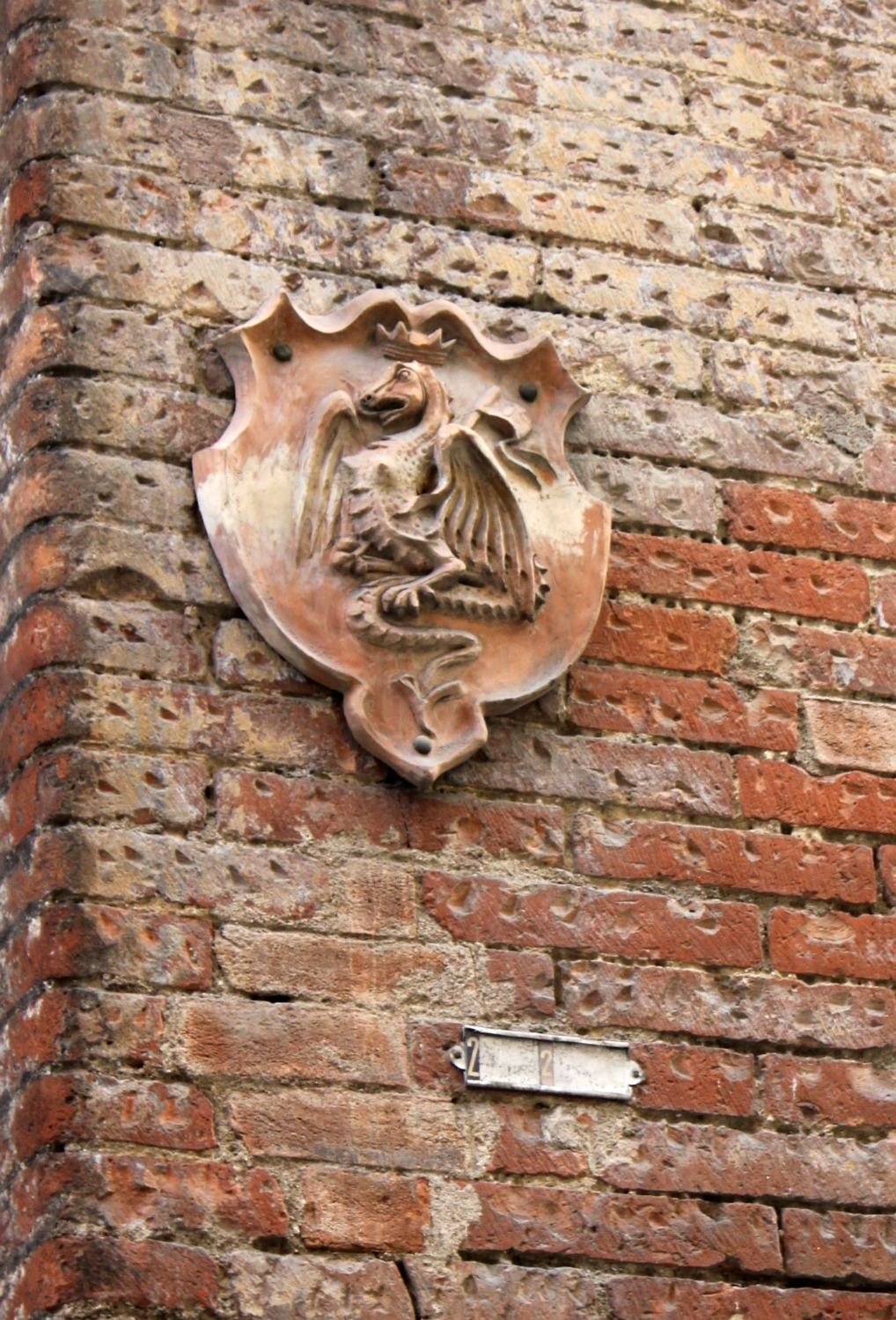 A dragon, one of the shields and emblems showing the animals and symbols representing Siena's 17 areas or contrada - exploring Siena with kids, our tour discovering art, history and animals