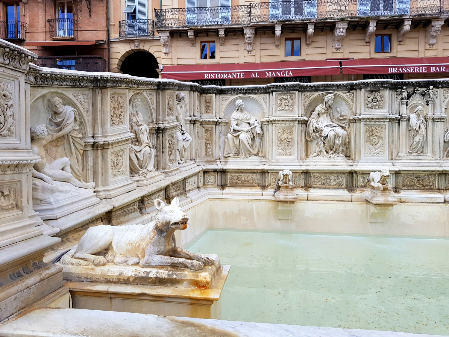 Stone wolves on the fountain in the Piazza del Campo where the Palio is run - exploring Siena with kids, our tour discovering art, history and animals