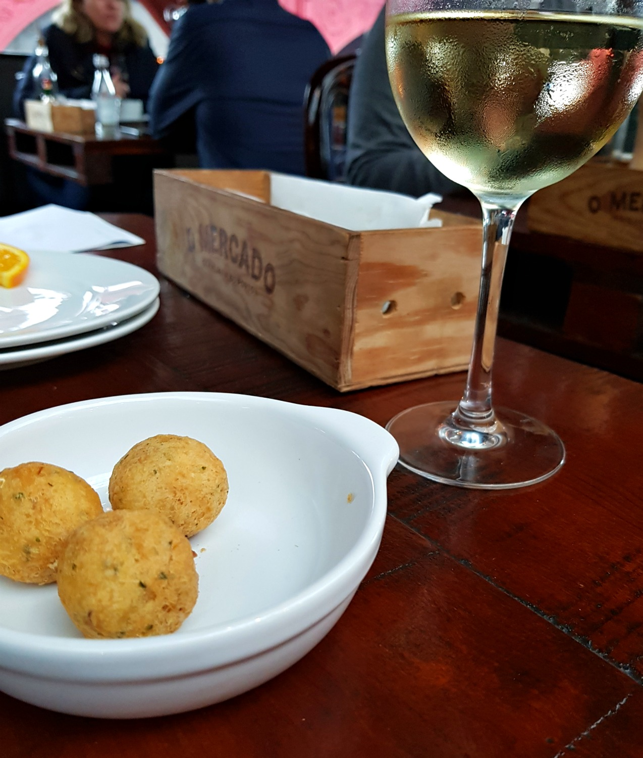 Bacalhau and wine to start one long lunch in a restaurant in Porto - my Porto travel tips and lessons for visiting the city with kids