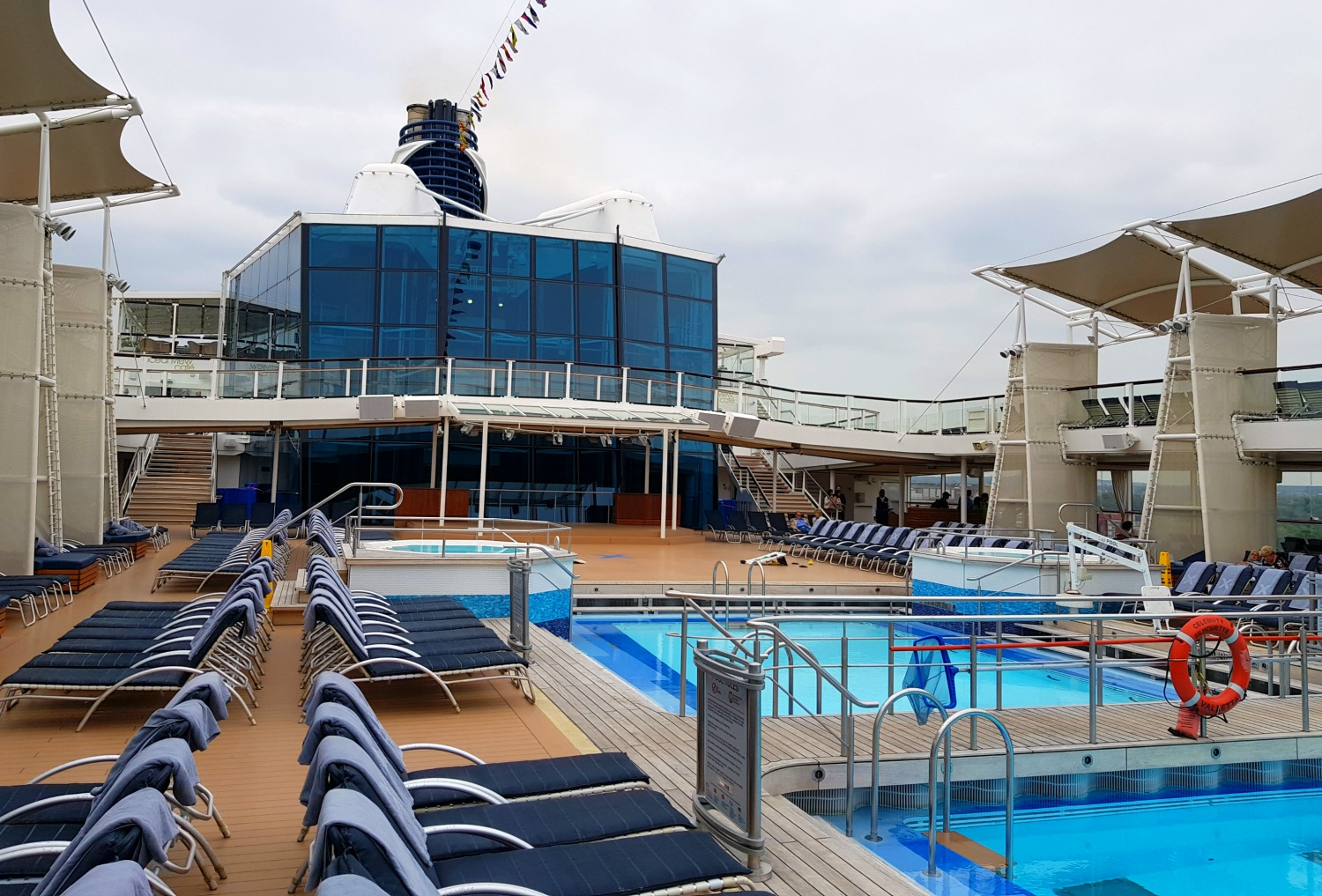 The pool desk of Celebrity Silhouette on a cloudy day - testing out Anturus Explorer Academy kids club activities from Celebrity Cruises
