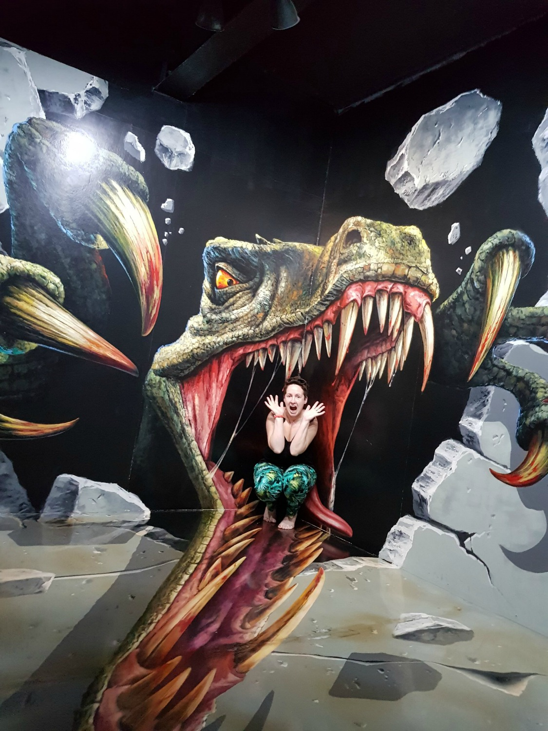 Me posing in a dinosaur's mouth at Langkawi Art in Paradise, one of Malaysia's 3D art museums