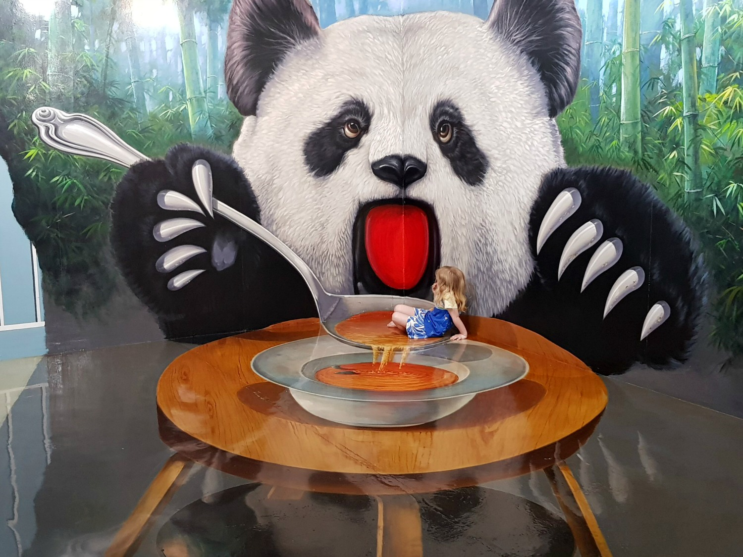 My daughter in a panda's soup bowl at Langkawi Art in Paradise, one of Malaysia's 3D art museums