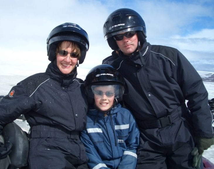 Family ready for snowmobiling in Iceland.