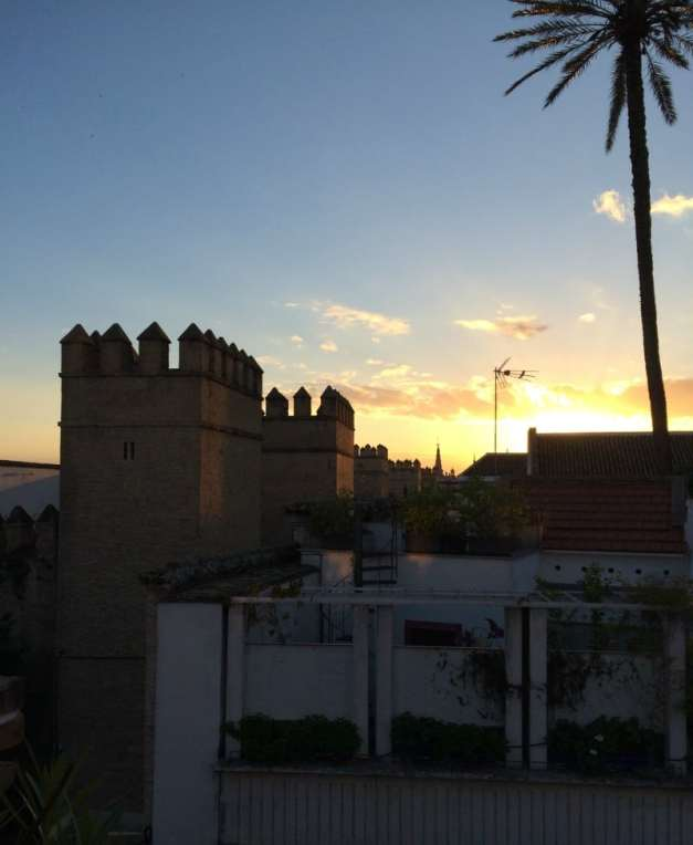 City walls of seville at sunset