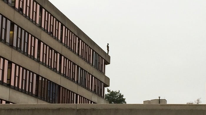 Antony Gormley figure on library roof, UEA