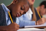 Schoolboy Writing in Notebook_MunaKalati