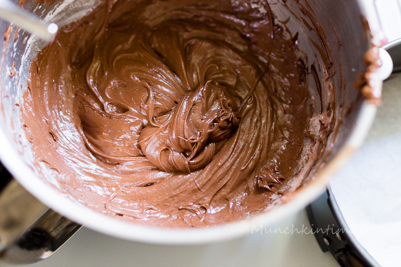Add flour, cocoa powder and baking powder to sifter and sift it into egg mixture.  Mix it with a mixer.