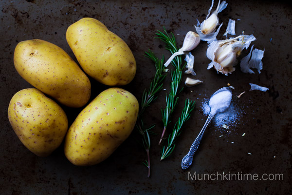 Perfect Roast Potatoes with Garlic and Rosemary - Roast on the outside and soft on the inside. Rosemary and garlic gives these potatoes amazing flavor in bite.