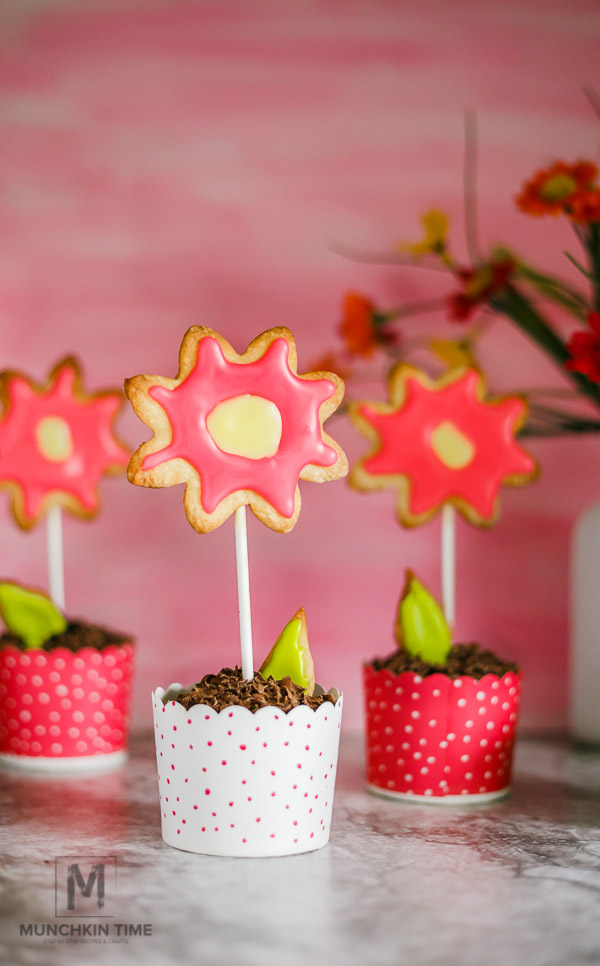 Delicious Mother's Day Flowers - made of Easy Cookie Recipe, colorful icing and chocolate muffins covered with shaved chocolate.