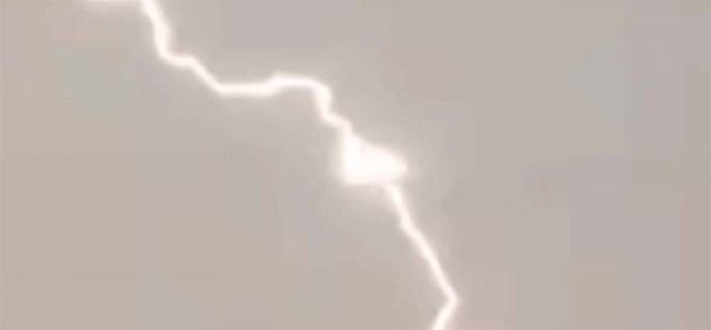 triangular UFO feeding the energy of lightning