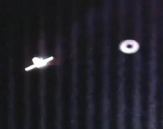 iss donut shaped ufo - UFOs and Donut Shaped UFO during the final stages of docking SpaceX Dragon and ISS May 25, 2012
