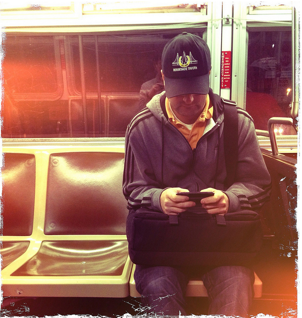 muni rider and phone by throgers