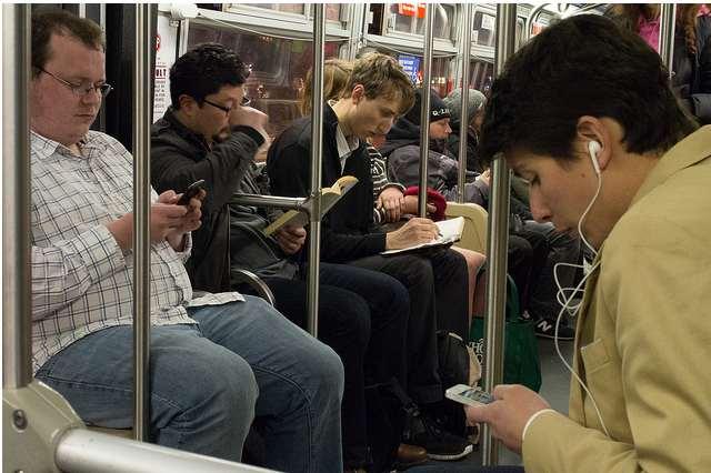muni riders cell phones