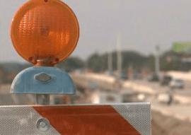 orange lane markers, asphalt, milwaukee asphalt