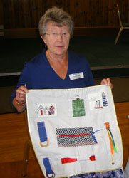 Lady with activity quilt