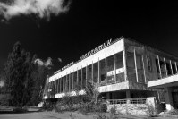 A stark black and white image showing a neo-brutalist concrete building