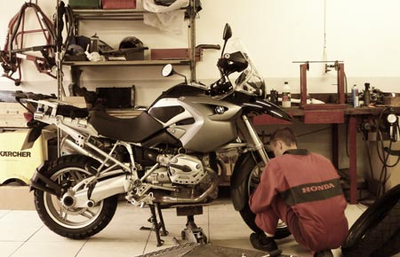 Mechanic works on bike. You want more?