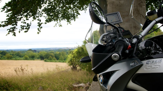 Side on view of the front of bike, looking into a field