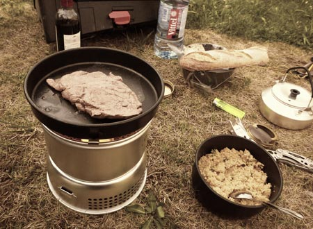 Camping stove cooking steak and couscous