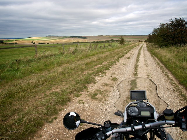 View over the bike's handlebars down an empty Ridgeway