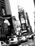 Black and white stylised image of skyscrapers and neon signs