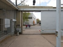View from inside the prison complex out onto children playing in the street