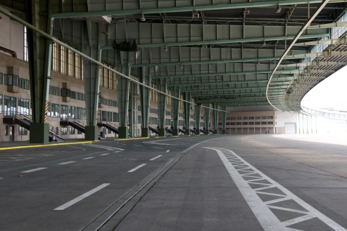 View from under Tempelhof's crescent shaped apron overhang, gates to the left, airfield to the right
