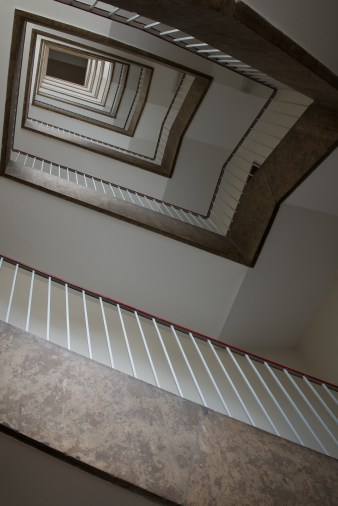 Looking up 9 flights of stairs inside the former largest building in the world