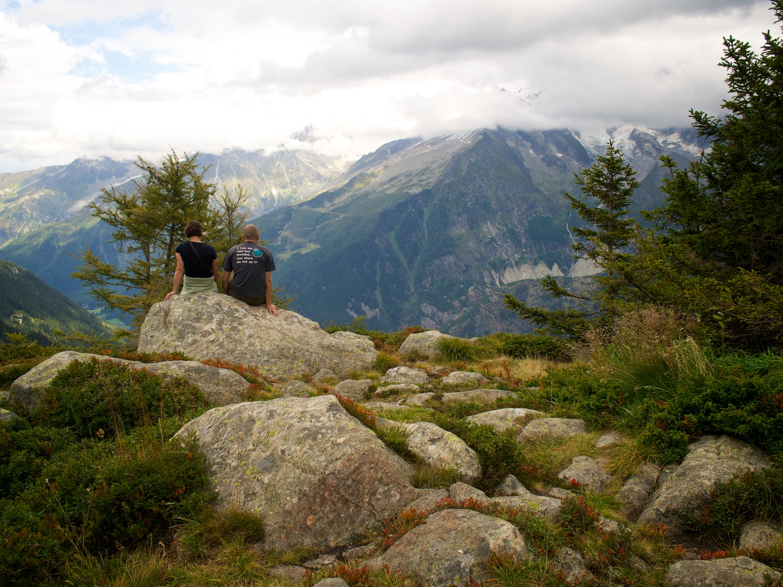 Couple sitting on a rock marvelling at Mont Blanc