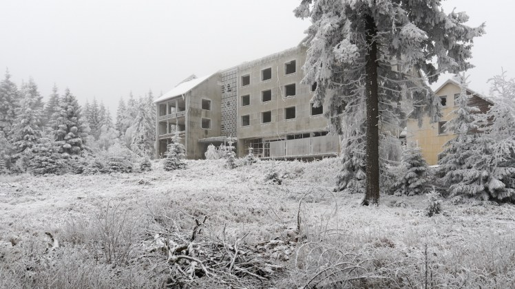 Exterior view of a smashed luxury guest house across frost-covered gardens