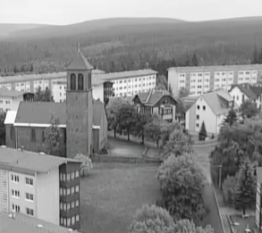 Elevated view of the church at Oberhof, surrounded by grey communist residential blocks