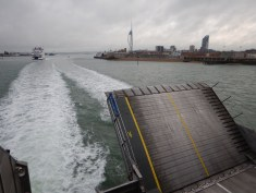 View towards the rear of a cross-channel ferry, loading ramp raised above wash.