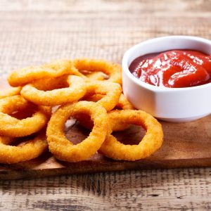 onion rings with ketchup on wooden board.jpg