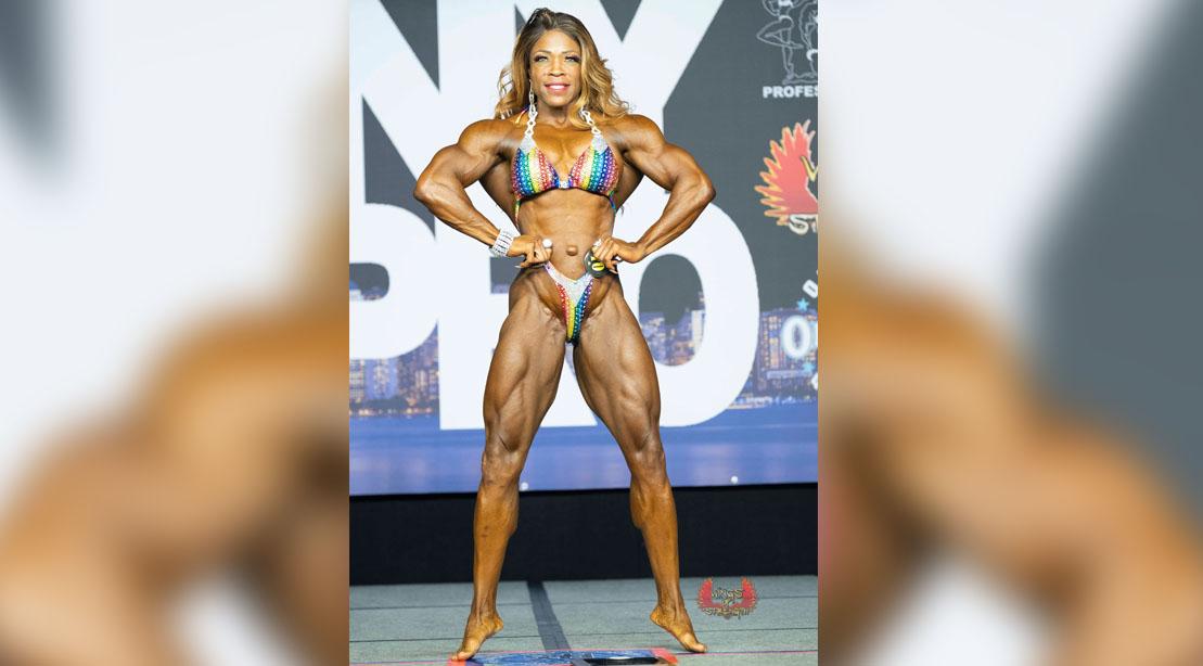 Female-Bodybuilder-Mayla-Ash-Posing-At-A-Female-Bodybuilding-Competition