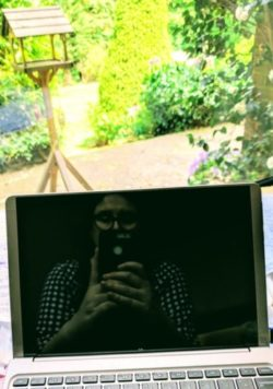Julie Reynolds reflection in her laptop