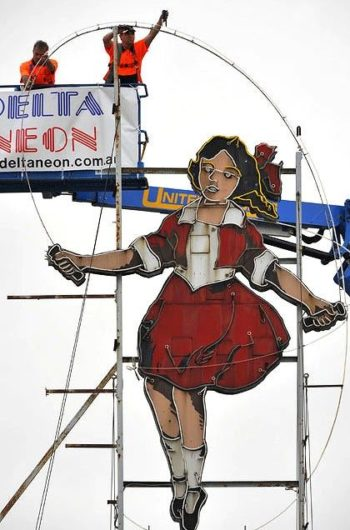 The new Skipping Girl Vinegar sign, being installed