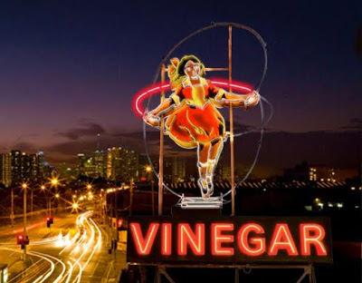 The Skipping Girl Vinegar sign