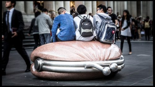 People sit on artwork 'The Public Purse'